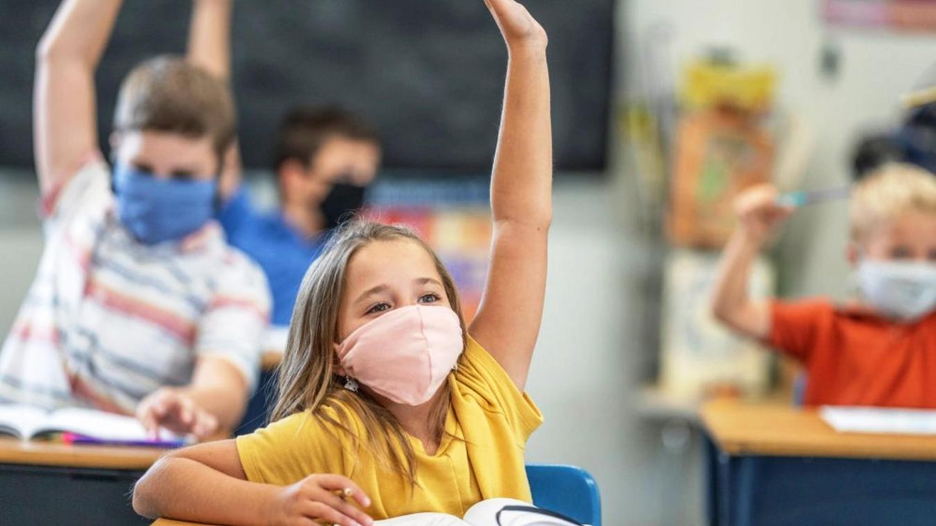 Pour les parents, contraindre les enfants à porter le masque pourrait être un préjudice. Photo d'illustration.